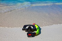 Accessory for Snorkeling _mask, flippers, tube_lay on sand on background of ocean