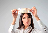 Woman controlling a euro banknote