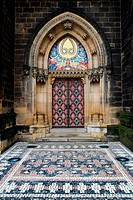 Main door to the neo_gothic Basilica of St Peter and St Paul in Prague, Czech Republic.