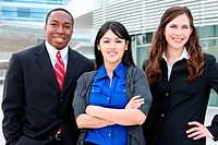 Attractive diverse business man and women team at office building