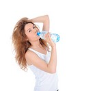Charming brunette drinking water from a bottle. Isolated on white background