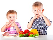 Boys and plates of vegetables and meat. Isolated on a white background