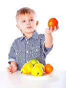 A boy and the plate of vegetables. Isolated on a white background
