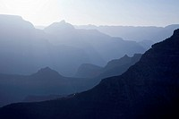 Scenic Layers of the Grand Canyon in the Early Morning with Hikers Cabin Roof Shining in the Lower Middle.