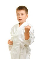 Karate boy demonstrating uppercut punch against white background