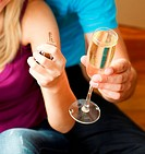Close_up of couple holding a key and a glass of champagne. Concept of buying house