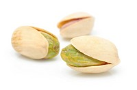 Close up of pistachios nuts in isolated white background