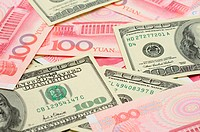Closeup of US dollar bills and China yuan bills