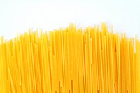 An image of spaghetti noodles in row