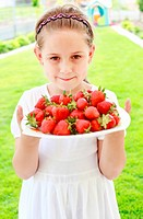 Girl holding fresh strawberries