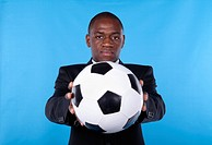 African businessman holding a soccer ball