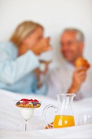 Blurred image of couple having breakfast in bed