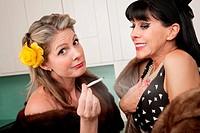 Two wealthy Caucasian women smoking marijuana in the kitchen