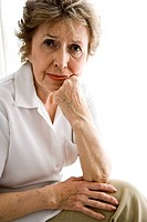 Portrait of senior woman in her 70s with serious expression