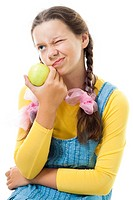Portret of a dissatisfied teenager girl with apple standing and smile,isolated on white
