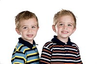 Identical twin boys, they are two years old, white background