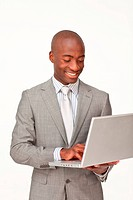 Afro_American businessman using a laptop against white background