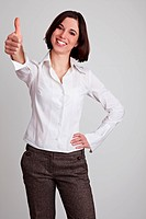 Happy smiling business woman holds her thumb up