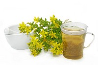 Herbal tea with Saint_John´s wort over white background