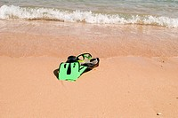 flippers and mask on a sand