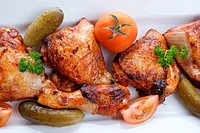 grilled organic chicken meat on a white plate