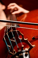 Close up of a cello player, studio shot