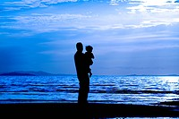 Father with his son by the beach _ silhouette