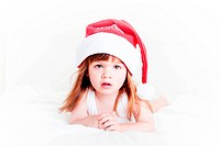 Pretty little girl wearing a santa hat on a white background