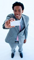 High angle of African businessman showing a small business card