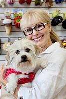 Portrait of senior pet owner shop with dog