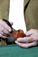 Close_up view of owner holding tobacco pipe