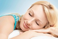 Closeup portrait of beautiful woman sleeping.