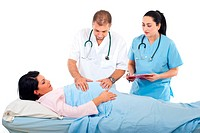 Doctor man holding hands on a pregnant tummy examinating while the nurse talking and holding a clipboard