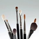 a detail of a make_up brush set, with the bristles set upwards, shot on a white background.