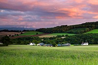 England, Devon, Warnicombe. Sunset over rolling countryside near Warnicombe village