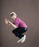 Happy teenage boy jumping midair