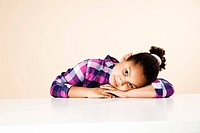 Girl resting her head on table