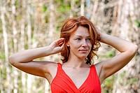 Portrait of red_haired adult woman in nature