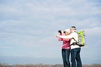 Couple standing outdoors with binoculars