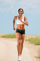 Healthy Natural Looking Young African American Female Runner under Summer Sunlight