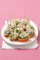 Crostini topped with a chicken and celery salad