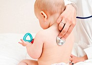 Children´s doctor exams infant with stethoscope