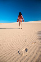 footsteps woman on dune