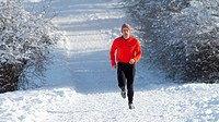 athlete running in a snowy landscape