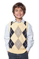 Studio portrait of young Hispanic boy smiling on white background