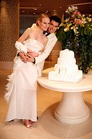 Bride and groom with cake (thumbnail)