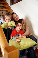 Mother with tired children on staircase (thumbnail)