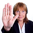 Older senior business woman´s arthritic hand with knobbly fingers in a stop talk to the hand gesture.