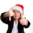 Older senior business woman´s arthritic hand with knobbly fingers in a 50 _ 50 hand gesture. Wearing a santa hat.