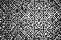 closeup of silver glass repeating vintage pattern with vignette